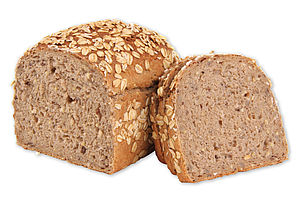 Par-baked Organic multigrain bread in box form sprinkled with oatmeal.