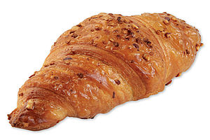 Pre-proved butter croissant with hazelnut-nougat creme filling and chopped hazelnuts as a topping.