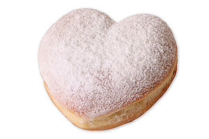 Fully baked doughnut in heartshape with a multi-fruit filling and powdered sugar.
